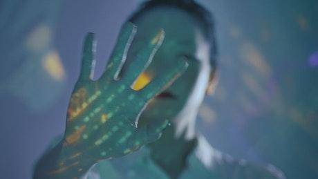 Female cyborg moving her hand