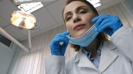 Female Dentist examining teeth