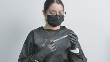 Female dentist with anesthetic