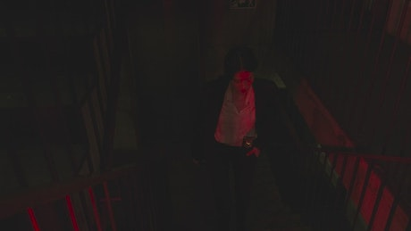 Female detective arriving at a crime scene in an apartment