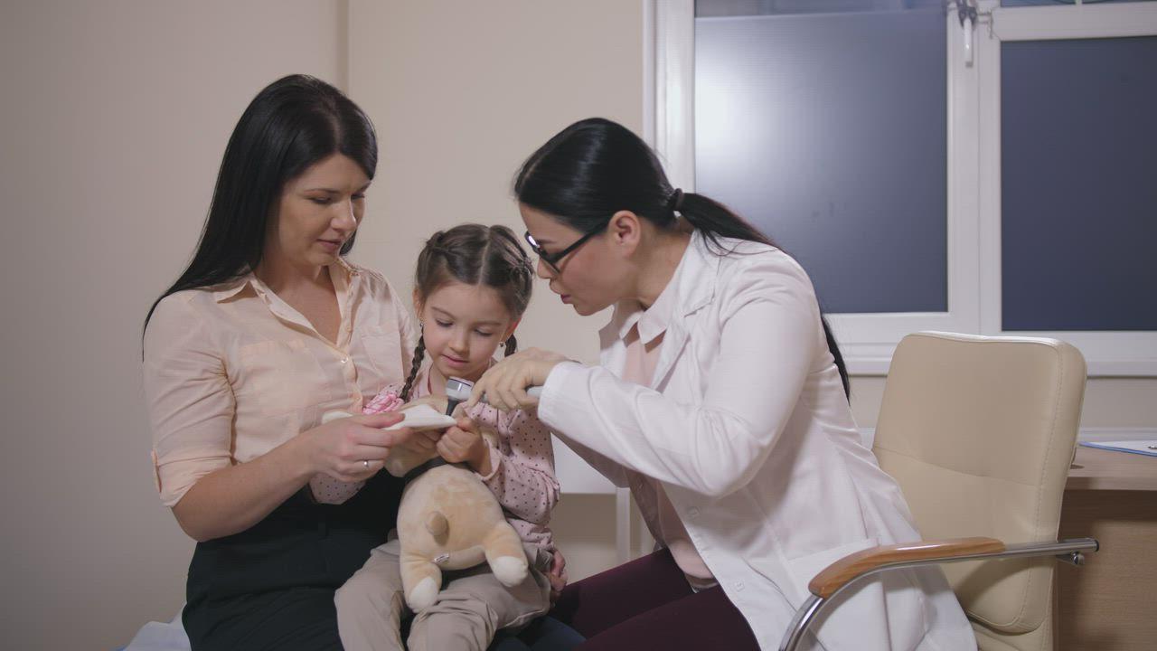Doctor examining child stock image. Image of baby, disease