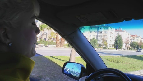 Female driver roading the city