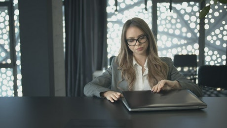 Female lawyer starts working with her laptop