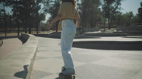 Female skater practicing skateboarding