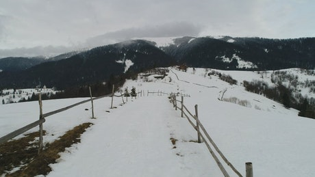 Fenced path in the snowy mountains