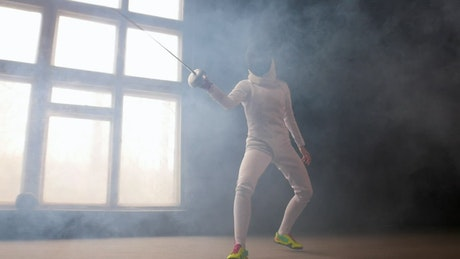 Fencer fighting with sword in hand