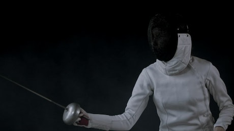 Fencer practicing basic attack movements