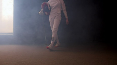 Fencer walking slowly before a combat