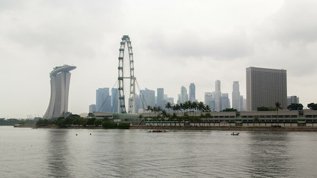 Ferris wheel and Singapore skyline on a cloudy day