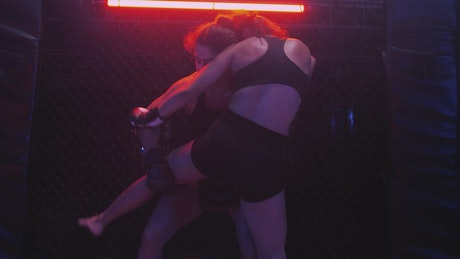 Fierce martial arts combat between two women