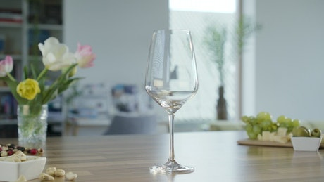 Filling a glass with white wine