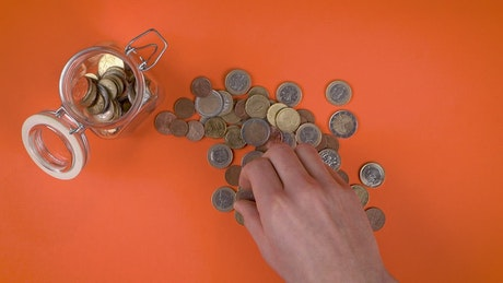 Filling jar glass with coins