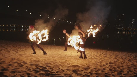 Fire jugglers on a beach