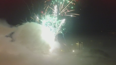 Fireworks exploding over the city