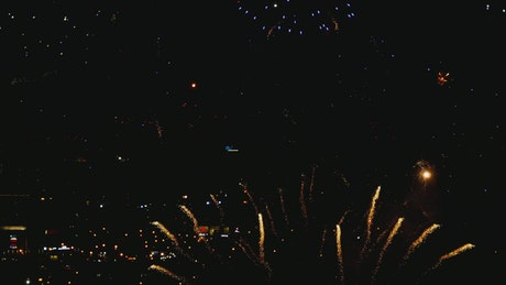 Fireworks illuminate the sky with a colorful explosion