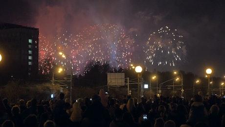 Fireworks over a city street
