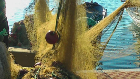 Fishermen collecting a fishing net