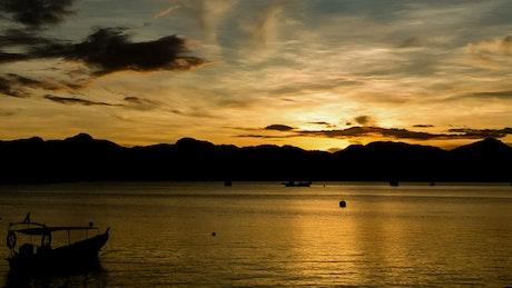 Fishing boats against the sunrise