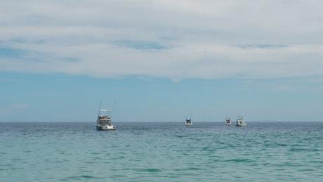 Fishing boats on calm sea