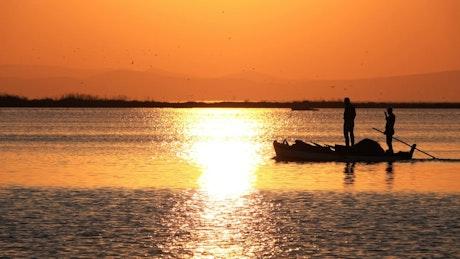 Fishing canoe at sunset
