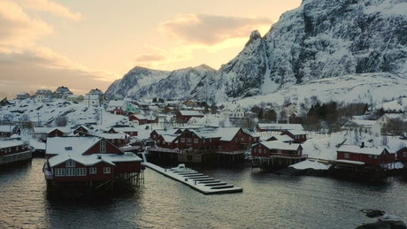 Fishing town village covered in snow in the sunset