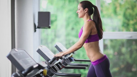Fitness girl on the treadmill at the gym