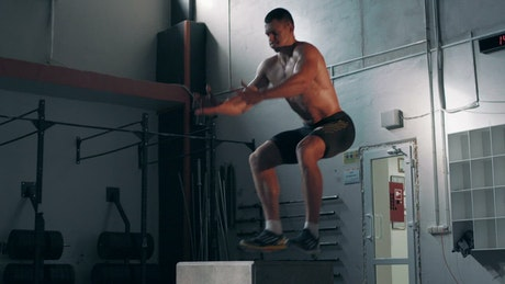 Fitness man doing jumping exercises