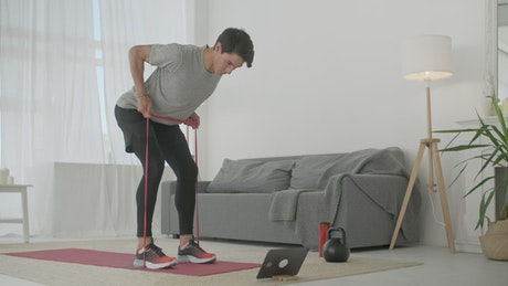 Fitness man exercising with elastic bands