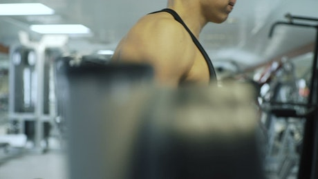 Fitness man lifting weights at the gym
