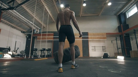Fitness muscular man doing CrossFit exercises