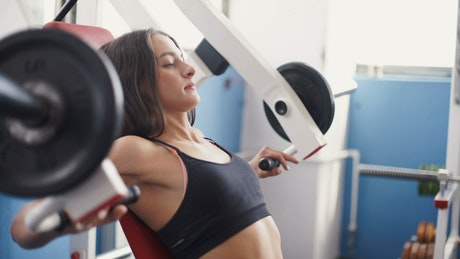 Fitness woman exercising her body in the gym