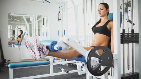 Fitness woman making effort on leg routine