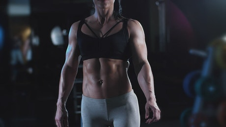 Fitness woman posing in a gym