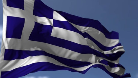 Flag of Greece waving by the wind, slow motion