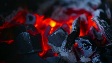 Flames and charcoal in a bonfire