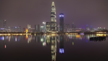 Flashing skyscraper in Shenzhen by a river