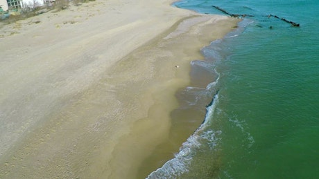 Flight over a sandy beach