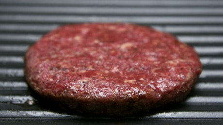Flipping a hamburger on the grill