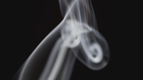 Floating smoke on a black background