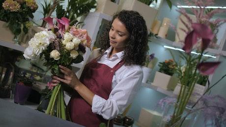 Florist creating a bundle of flowers