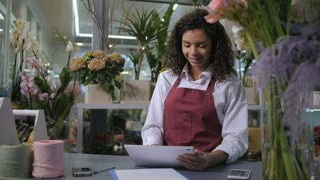 Florist using a tablet to take orders
