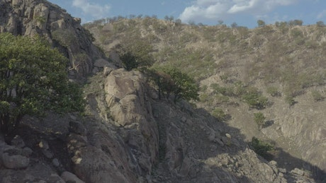 Fly over a mountain range in an arid environment