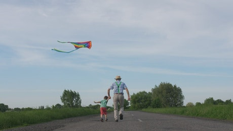 Flying a kite with his Grandpa