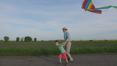 Flying a rainbow kite