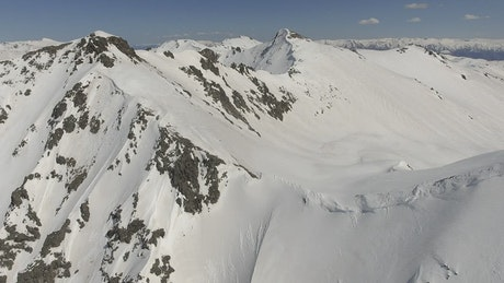 Flying above the snowy mountains