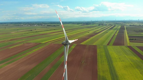 Flying around a wind turbine in the countryside
