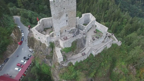 Flying away from the medieval castle in the middle of the forest