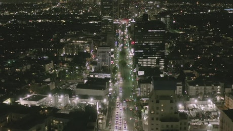 Flying down a main avenue in Los Angeles at night