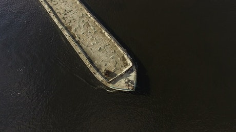 Flying over a cargo ship in the river