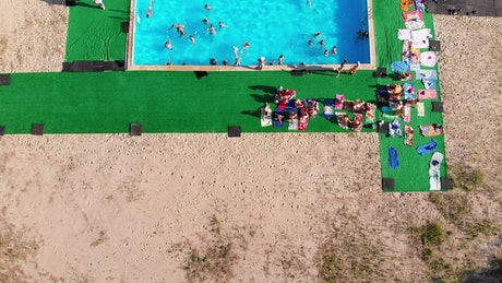 Flying over a crowded swimming pool